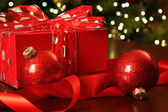 Red Christmas gift with ornaments — Stockfoto