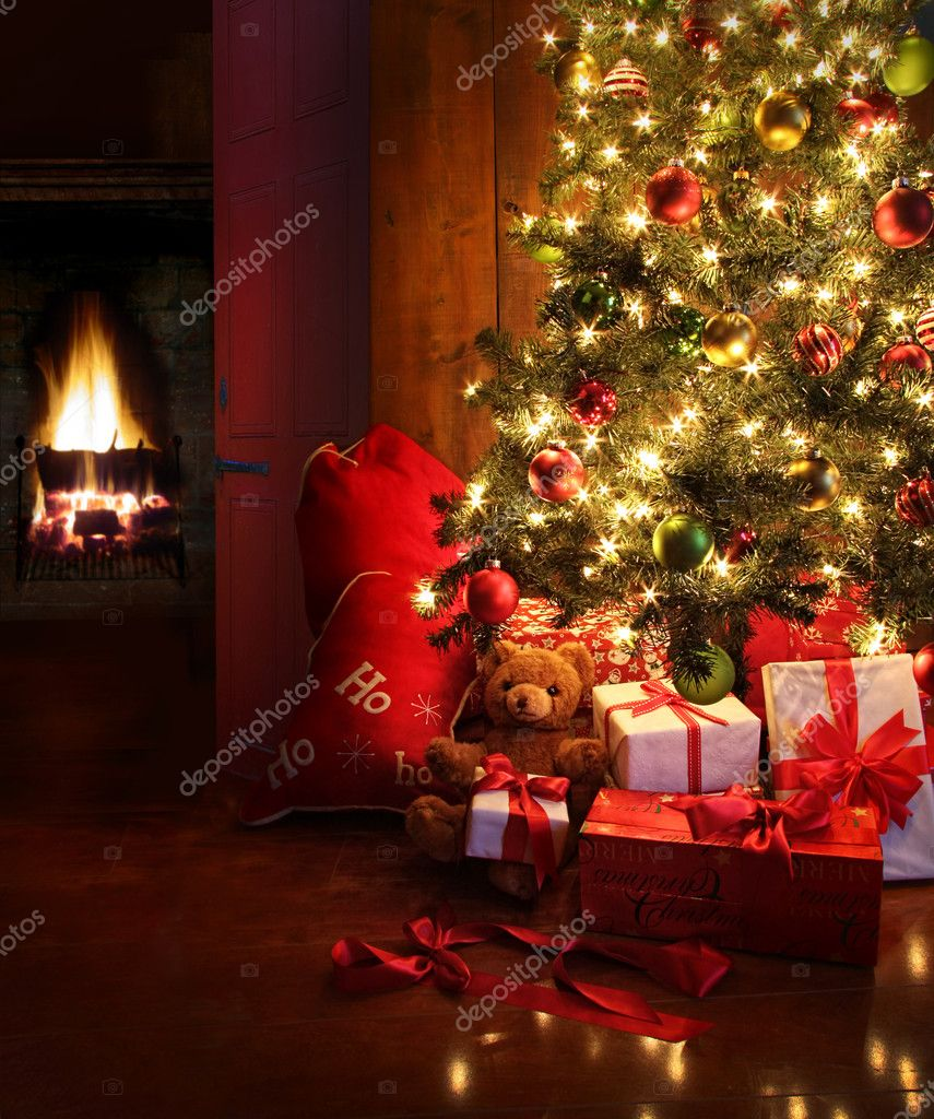 Christmas scene with tree  gifts and fire in background — Lizenzfreies Foto #7371255