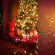 Christmas scene with tree and fire in background — Stok Fotoğraf #7523316