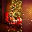 Christmas scene with tree and fire in background — Stockfoto #7523316