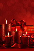 Christmas candles on a red background — Stock Photo