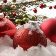 Red christmas balls in the snow — Stock Photo