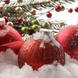 Red christmas balls in the snow — Stock fotografie