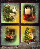 Vignettes of Christmas scenes seen through a wooden window — Stock Photo