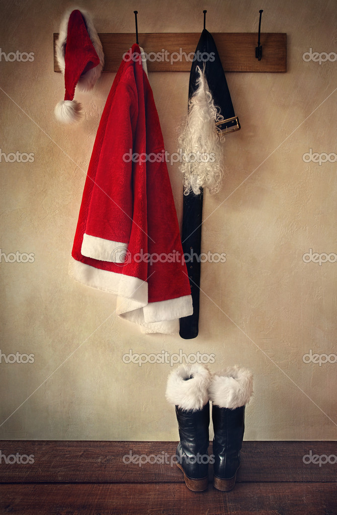 Santa costume with boots on  coat hook  Stock Photo #7743826