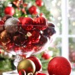 Red Christmas balls on table — Stock Photo