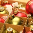 Christmas balls in box with paper wrapping — Stock Photo