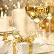 Gold ribbon gift with gold background — Stock Photo