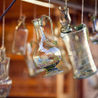 Decanters of bohemian glass hanging on hooks — Stock Photo #6955909