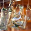 Decanters of bohemian glass hanging on hooks — Stock Photo #6956136