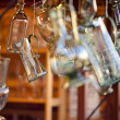 Decanters of bohemian glass hanging on hooks — Stock Photo #6956143