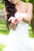 Juicy red raspberries in the hands of the bride — Stock Photo