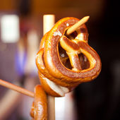 Pretzel hanging on a branch — Stock Photo