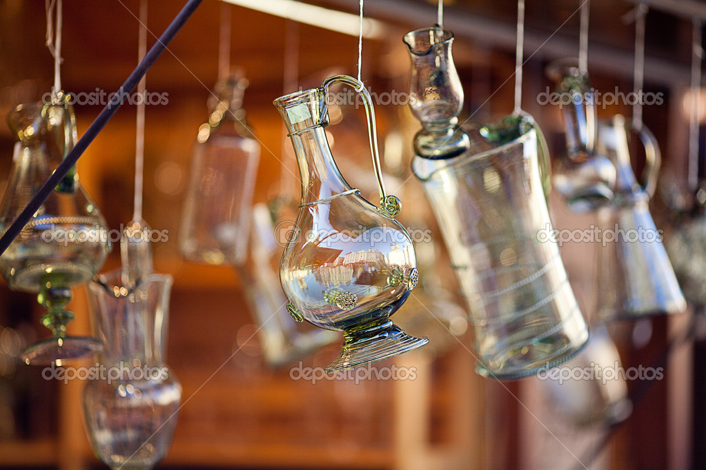 Decanters of bohemian glass hanging on hooks — Stock Photo #6956137