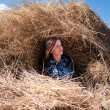 Stock Photo: Young womin haystack