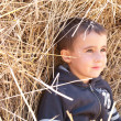 Little boy in haystack — Stock Photo