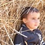 Little boy in haystack — Stock Photo
