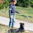 Little boyt plays with dog outdoors — Stock Photo #7018097
