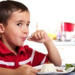 Little boy with spoon eats dessert — Stock Photo #7133342