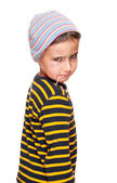 Little bully with toothpick and black eye in striped sweater — Stock Photo