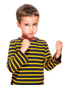 Little bully boy with black eye in fighting stance — Stock Photo