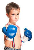 Little bully boy with black eye in boxing gloves fighting stance — Stock Photo
