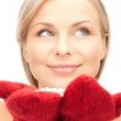 Woman in mittens with snow — Stock Photo #6764425