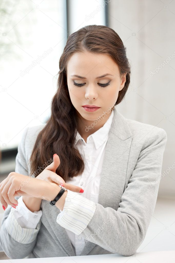 Bright picture of attractive businesswoman with watch  Stock Photo #6818427