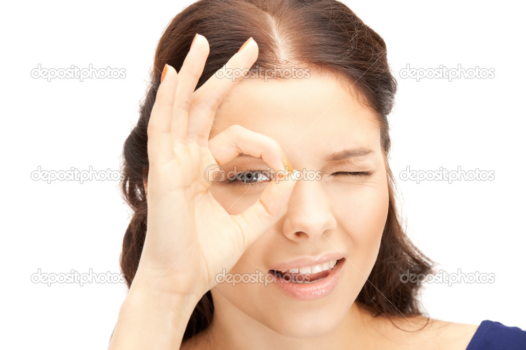 Picture of lovely woman looking through hole from fingers — Stock Photo #6841860
