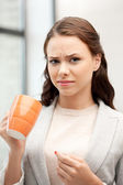 Lovely businesswoman with mug — Stock Photo