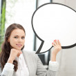 Smiling businesswoman with blank text bubble — Stock Photo #6860032