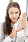 Businesswoman with watch — Stock Photo