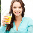 Beautiful woman with glass of juice — Stock Photo #6904326
