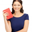 Happy and smiling woman with book — Stock Photo #6909939