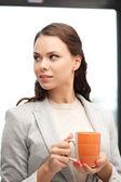 Lovely businesswoman with mug — Stock Photo