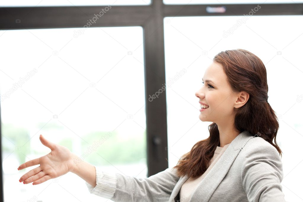 Lovely woman with an open hand ready for handshake — Stock Photo #6904120