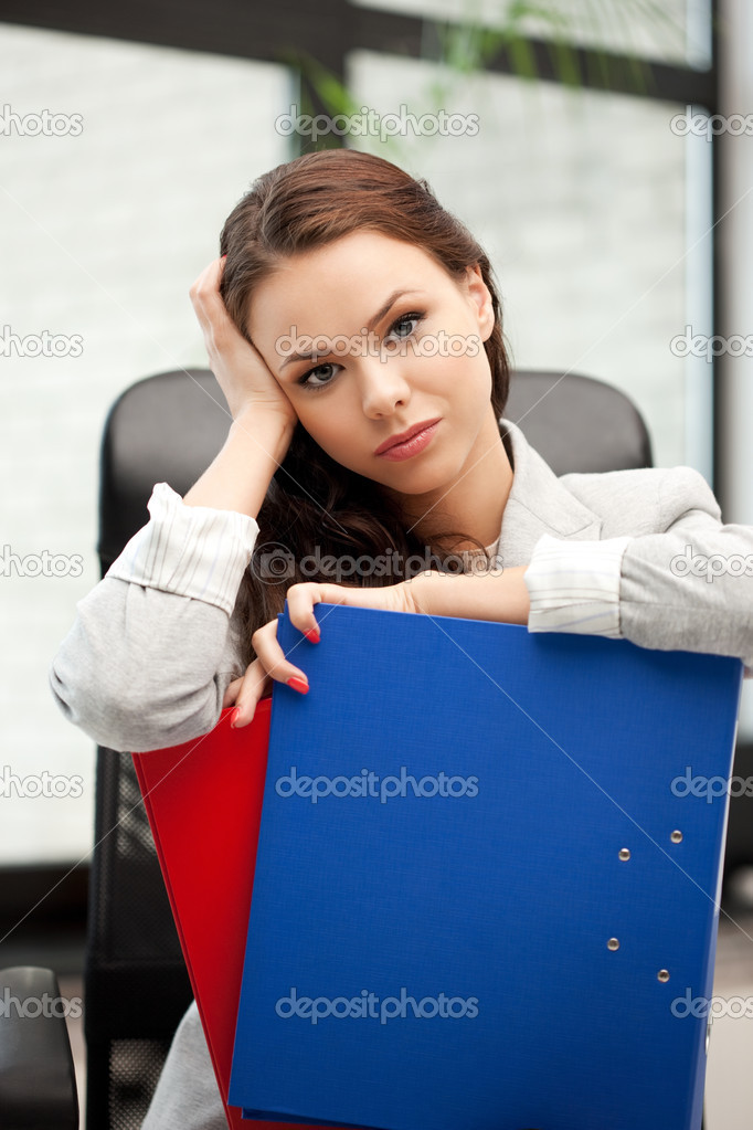Picture of young businesswoman with folders sitting in chair — Stock Photo #6944462
