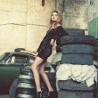 Fashionable woman in retro garage - Stock Photo