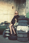 Fashionable woman in retro garage — Stock Photo