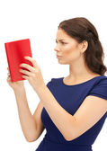 Calm and serious woman with book — Stockfoto