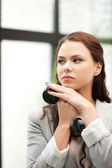 Businesswoman with phone — Stock Photo