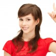 Teenage girl with her finger up — Stock Photo #7078231