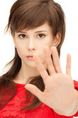 Teenage girl making stop gesture — Stock Photo