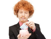 Man with piggy bank and money — Stock Photo