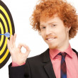Businessman with dart and target — Stock Photo