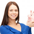 Lovely woman with piggy bank — Stok fotoğraf