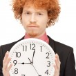 Man with clock — Stockfoto