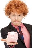 Man with piggy bank — Stock Photo