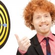 Stock Photo: Businessman with dart and target