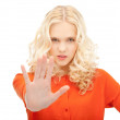 Woman making stop gesture — Stockfoto